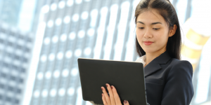 Picture of Woman on Laptop, using WebDrive instead of VPN
